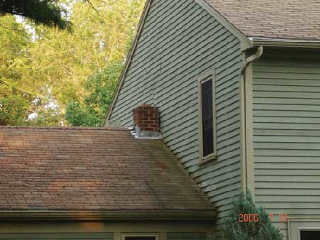 Chimney sitting next to the added side of the house