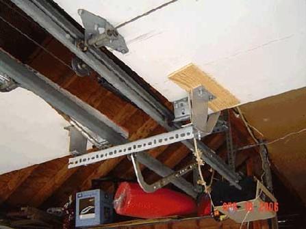 2 garage door garage with brackets holding them together